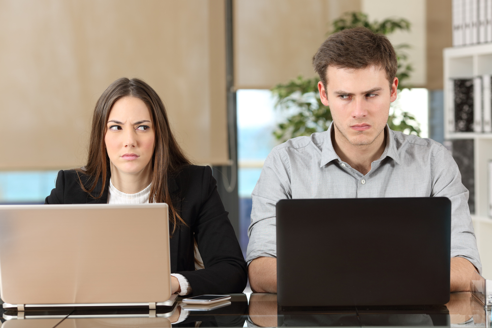 Photo of two colleagues who look like they have had an arguement